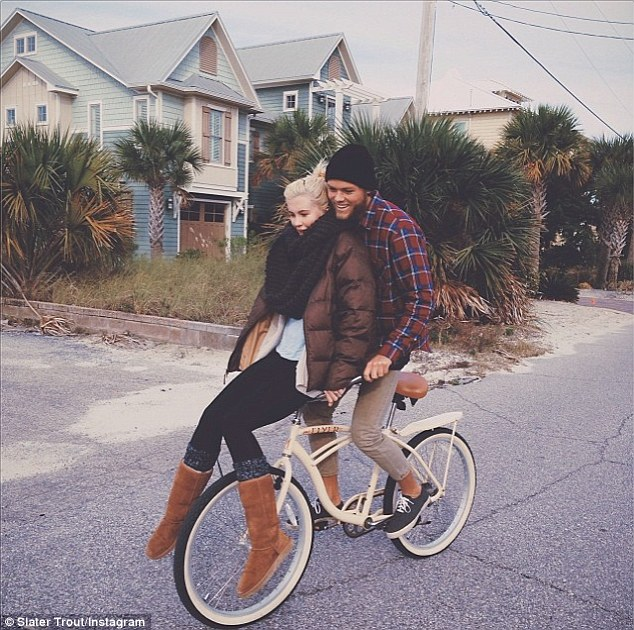 Beach babes: Ireland Baldwin and boyfriend Slater Trout rugged up against the cold as they hopped on a bicycle together for a sweet ride