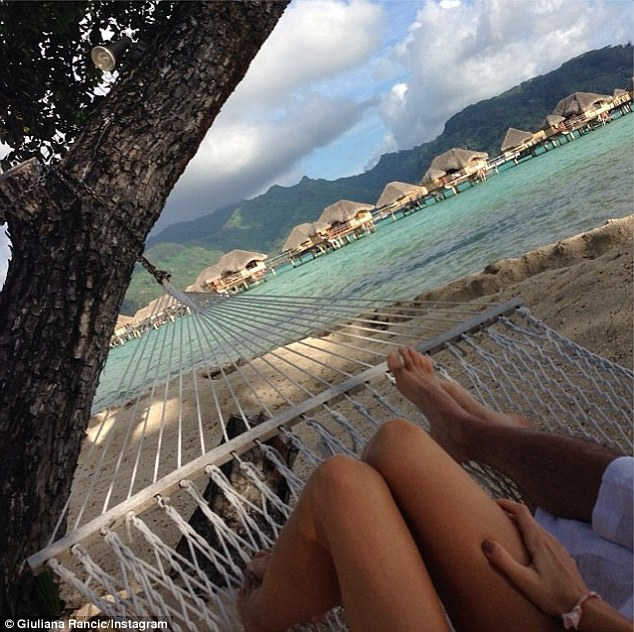 Tropical escape: Giuliana and Bill Rancic decided to forgo slaving away for hours in a hot kitchen in favour of a relaxing and romantic vacation in Tahiti, where they enjoyed a cosy snuggle on a hammock