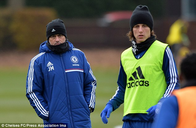 Targeted: Mourinho (left) looks on as David Luiz (right) trains as Barcelona ponder a move for the defender