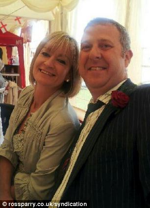Jayne Rowley, 47, pictured here with husband Martin, 45, at their daughter Victoria's wedding