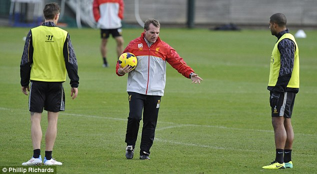 Instructions: Rodgers talks tactics with Johnson (right) and Daniel Agger (left) and, seemingly pleased with what he witnessed during the session, walks off (below)