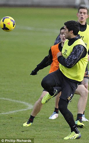 Up and about: Suarez gets involved