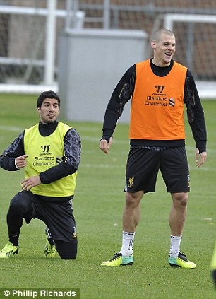 All smiles: Suarez gets to his feet as Skrtel has a laugh