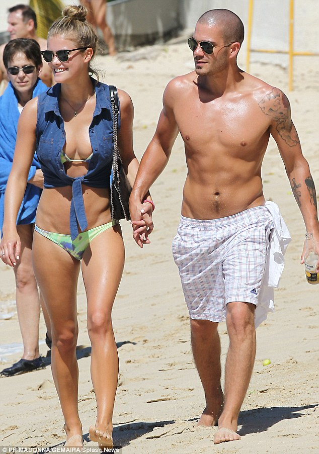 Handsome couple: The Mancunian and the Scandinavian certainly looked good together as they strolled on the beach
