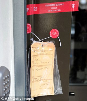 Crime scene: A police notice is attached to the door of the jewellery shop