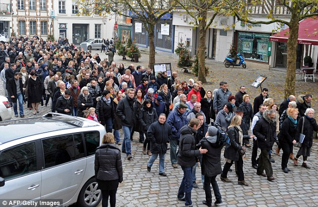 Locals in the commune of Sezanne march in support of the jeweller following his arrest for the shooting