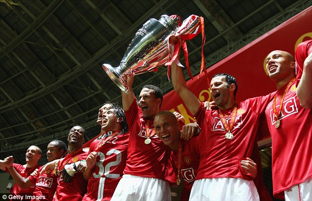 Magical moment: Giggs (second from right) lifts the 2008 Champions League trophy with defender Rio Ferdinand
