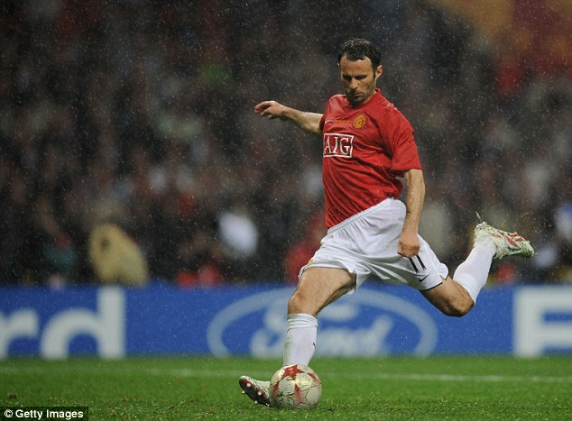 Cool, calm and collected: Giggs scores his spot-kick in rainy Moscow during United's Champions League final victory against Chelsea in May 2008