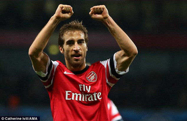 Cutting issue: Arsenal's Mathieu Flamini broke with club tradition and did not wear long sleeves on his shirt like the club captain against Marseille in the Champions League