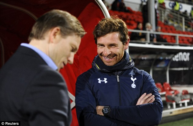 Calm before the storm: Tromso's manager Steinar Nilsen, left, speaks to Tottenham boss Andre Villas-Boas ahead of their Europa League game but Manchester United are next up for Spurs on Sunday