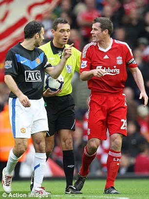 Familiar foes: Giggs (left) and Carragher argue with the referee as Liverpool run out 2-0 winners over United in October 2009
