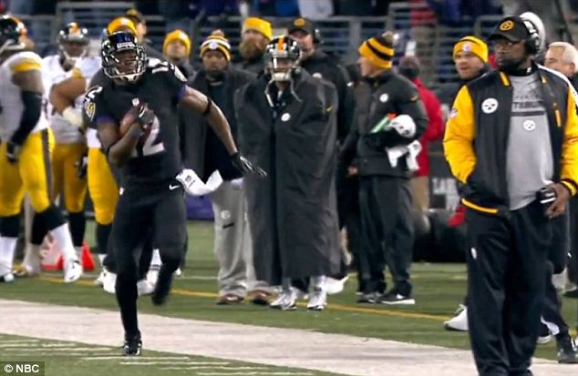 Taking a peek: From this angle it looks as though Steelers coach Mike Tomlin knows exactly where Ravens wide receiver Jacoby Jones is, as he stands very close to the end of the field