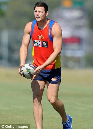 GOLD COAST, AUSTRALIA - AUGUST 28:  Steven May of the Suns kicks a NRL ball after a Gold Coast Titans training session at Metricon Stadium on August 28, 2013 on the Gold Coast, Australia.  (Photo by Matt Roberts/Getty Images)