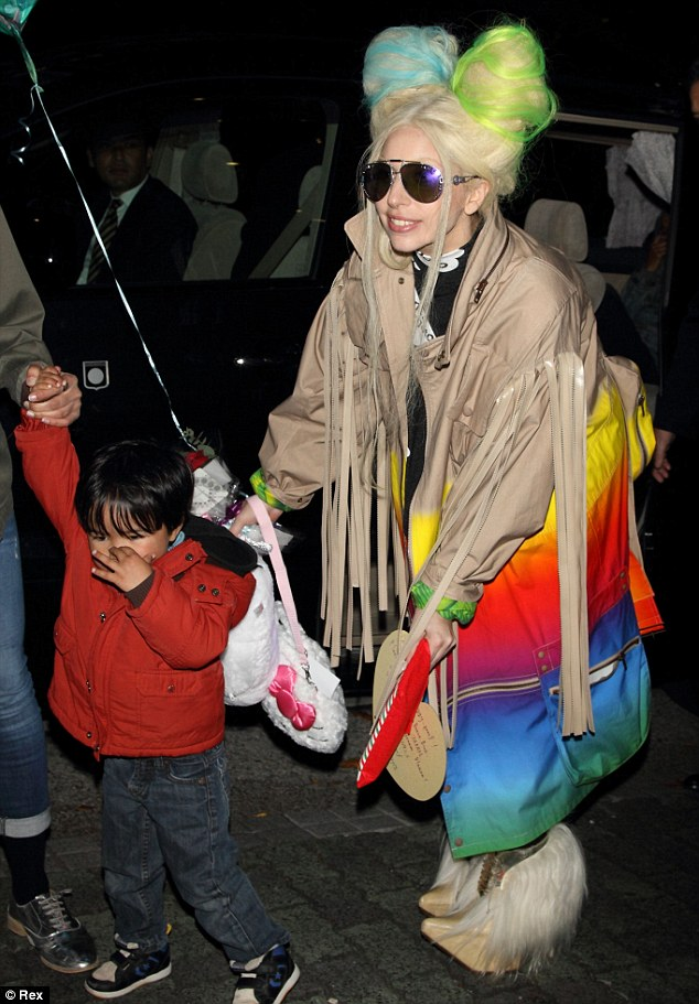 Her youngest fan: Lady Gaga bent down to have her picture taken with one of her youngest fans