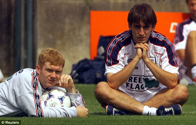 Had it hard: Scholes says he and Neville (right) had stricter coaches than the kids of today