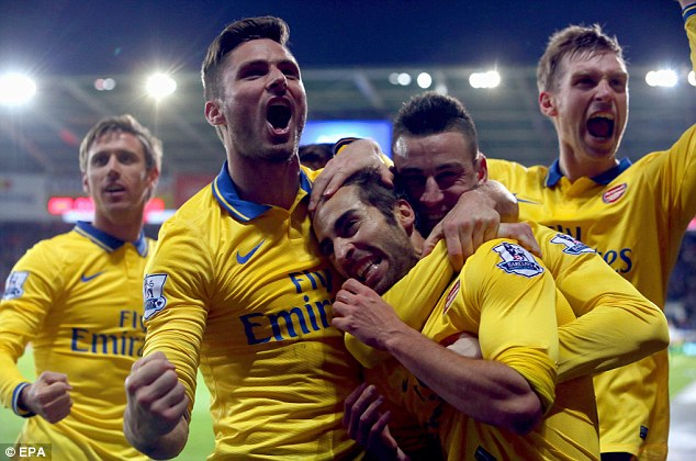 Rare strike: Arsenal players congratulate Mathieu Flamini, centre, after he scored Arsenal`s second goal against Cardiff