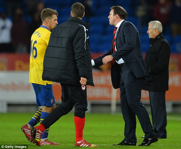 Mutual respect shown: Cardiff manager Malky Mackay shakes former Bluebird Ramsey's hand after the final whistle