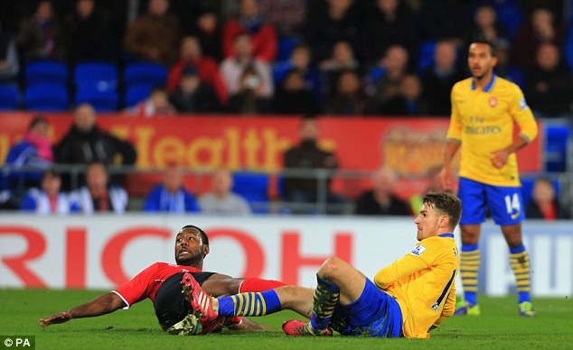 Icing on the cake: Ramsey scores his second goal and Arsenal's third, beating Cardiff defender Kevin Theophile Catherine