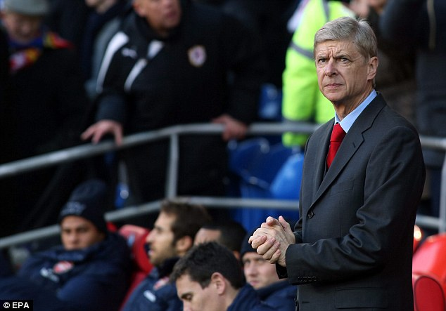 At a loss to explain position: Arsenal manager Arsene Wenger cannot believe his side are seven points clear at the top of the Premier League