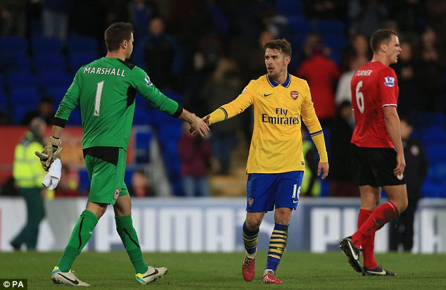 Showing respect: Arsenal's Aaron Ramsey, centre, shakes hands with Cardiff goalkeeper David Marshall after the game