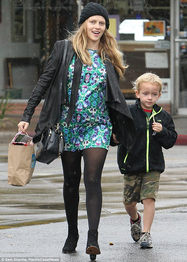Sweet time: Palmer took her soon-to-be stepson Isaac by the hand has they enjoyed a little retail therapy and candy