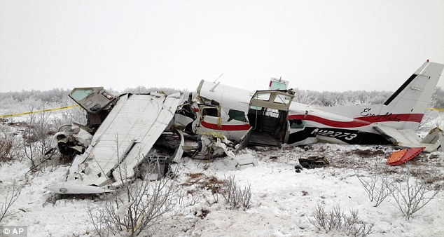 Crash: The wreckage of the plane which came down near a remote Alaskan village