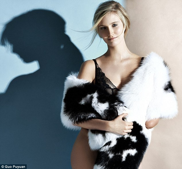 A stunning picture of Kelly Knox modelling fur and lingerie in the April issue of Marie Claire China