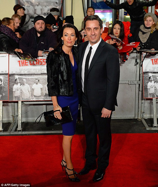 One of the super six: Former Manchester United and England footballer Gary Neville and his wife Emma posed for pictures as they arrived at the world premiere of the documentary