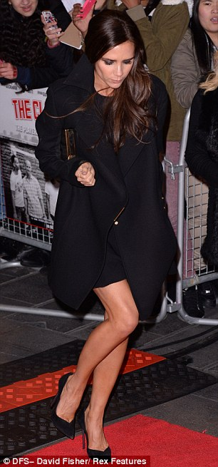 Strike a pose: Victoria showed off her tanned legs in a very short skirt and black stilettos