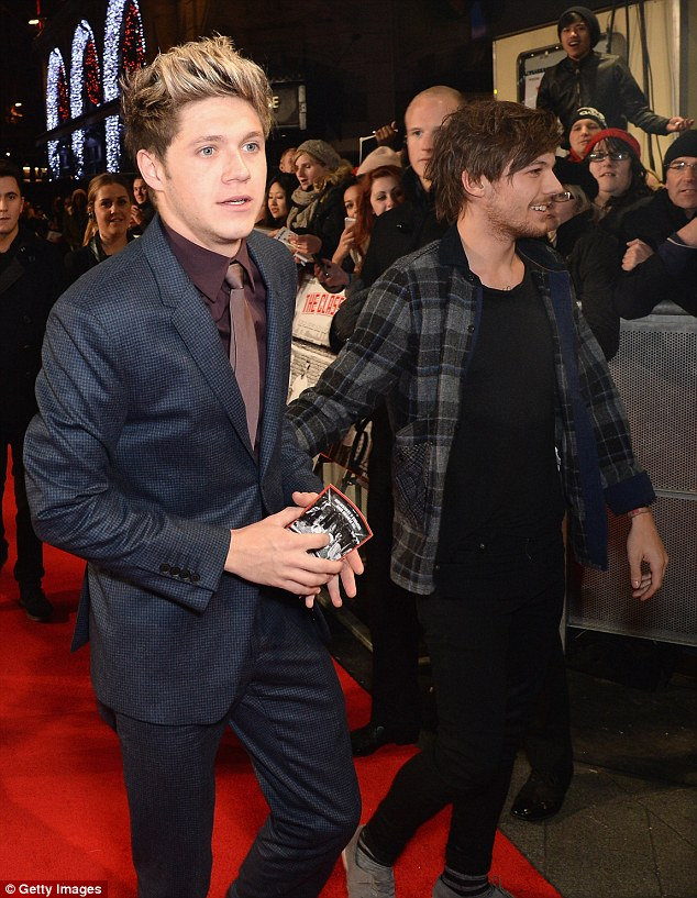 As you like: Louis Tomlinson and Niall Horan attend the event looking more casual than their bandmates