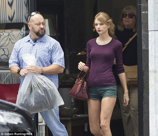 She bagged it: The 23-year-old singer found a few things she liked during her shopping trip and let her bodyguard carry the bag