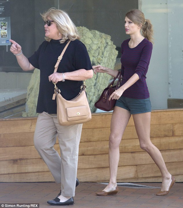 Hungry retailer: Taylor Swift was in her stride as she hit the stores in Auckland, New Zealand with her mother on Sunday ahead of her last show in the country