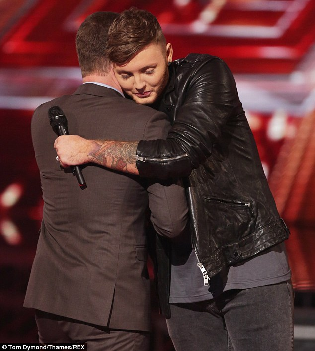 Moving on: The former X Factor winner was greeted with a hug from Dermot