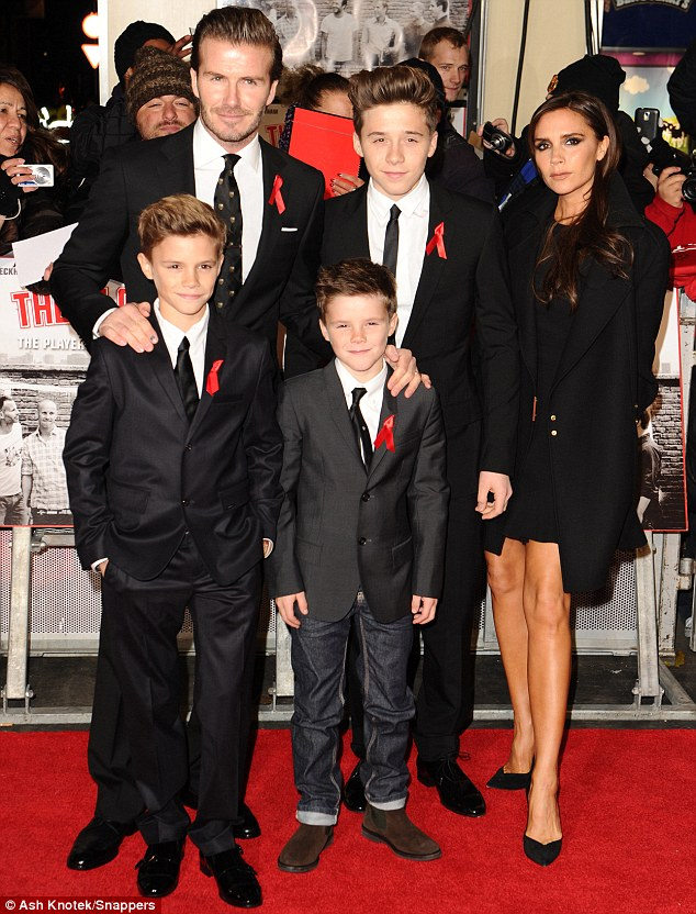 Family night out: The fashion designer joined David and their sons, Brooklyn, 14, Romeo, 11, and Cruz, eight, on the red carpet at London's Odeon West End in Leicester Square