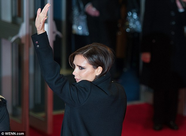 Dedicated: Victoria waved to her army of devoted fans as she enjoyed her family night out with her boys