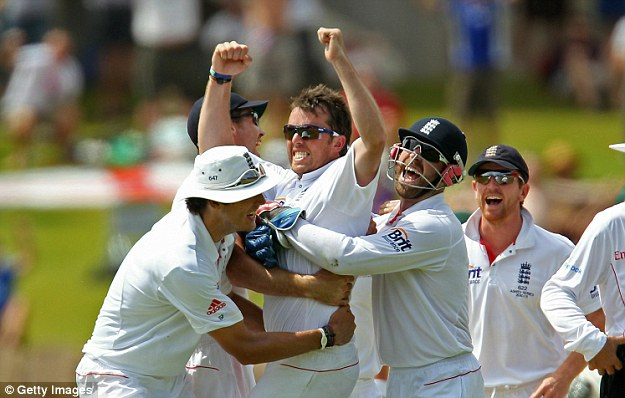Top form: Graeme Swann celebrates with his team mates as he got a five-for in Adelaide in 2010