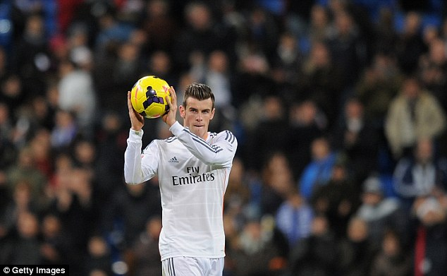 Hat-trick hero: Bale takes away the match ball after scoring three goals for Madrid against Real Valladolid
