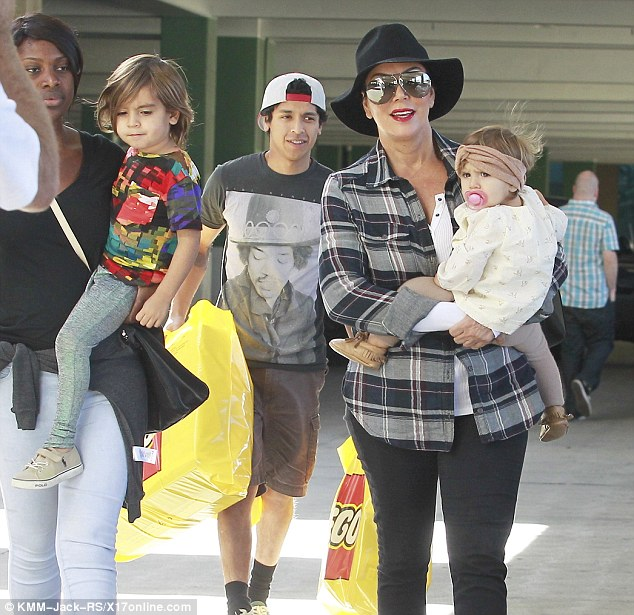 Family outing: Kris Jenner spends time with Penelope and Mason taking them to the Leggo store with the nanny