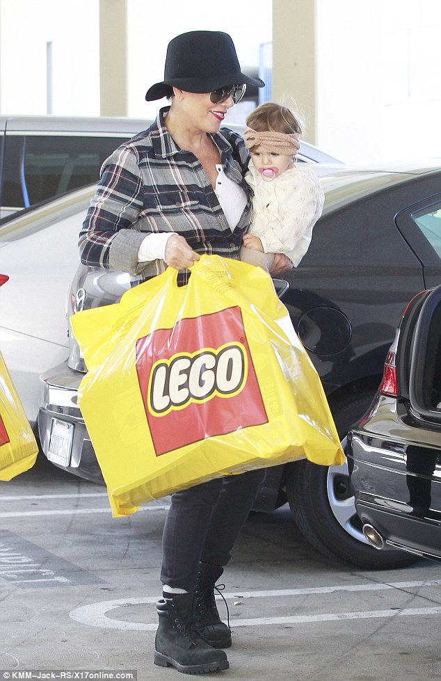 Shopping spree: Kris clearly treated her loved ones to toys and games during their trip