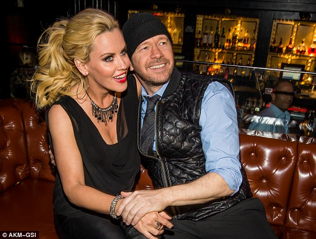 Blossoming romance: Jenny and Donnie, a former singer with eighties boy-band New Kids on the Block, started dating in July