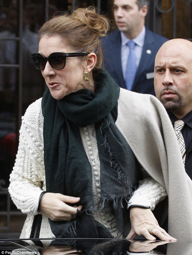 Not a good look: Celine Dion pulls an unflattering face as she steps out in Paris