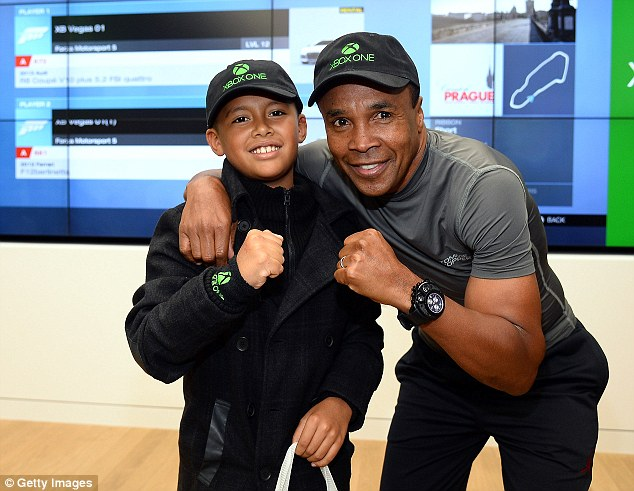 Still in tip-top shape: Sugar Ray, now 57, posed with a fan November 23 at an X-Box event in Las Vegas