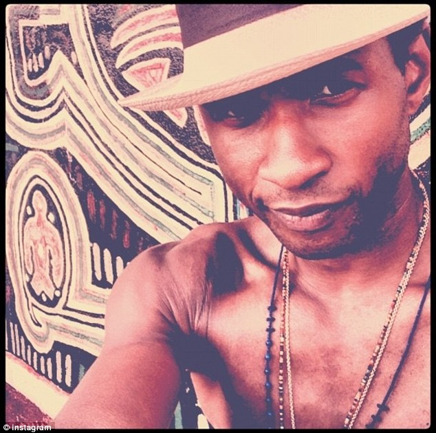 Shirtless selfie: Usher posted this photo early Sunday morning
