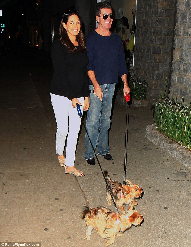 Proud parents of puppies: Silverman and Cowell are gleefully happy with their twin Yorkies
