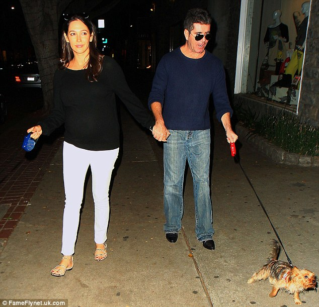 Follow me: Cowell led both his leading lady and his canine kid out for a walk on Robertson Blvd. in West Hollywood