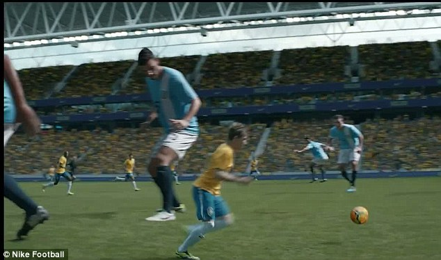 Tall order: Luiz rampages through the field in the Nike advert