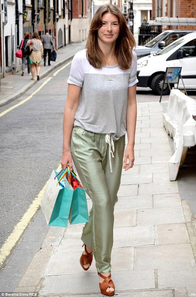 Glam: Jools Oliver was seen dressed up in a glam pair of shiny trousers and heels for the Mothercare Baby K Collection in July