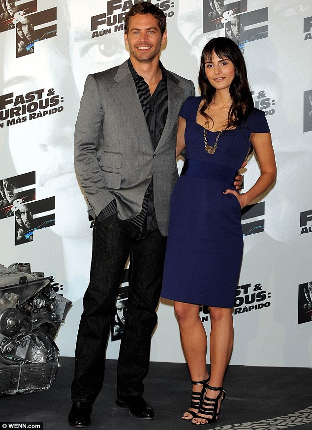 'I can't believe he's gone': Paul Walker's co-star Jordana Brewster, pictured with him here in 2009, has also tweeted her sadness at his passing