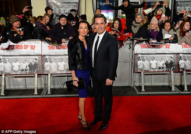 On the red carpet: Gary Neville (right) and his wife Emma pose for pictures ahead of the Class of '92 premiere