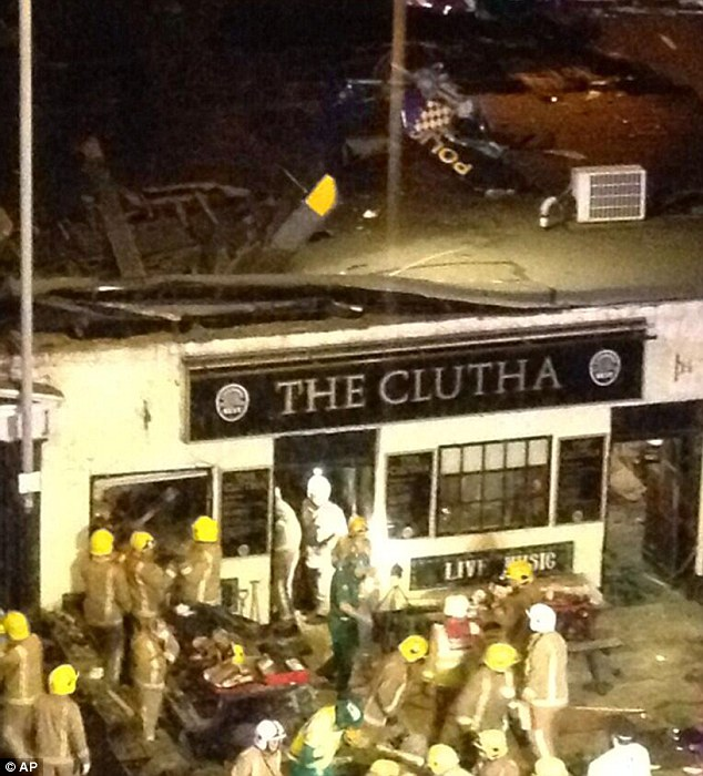 Authorities fear more bodies may be trapped in the wreck of the pub after the helicopter crash